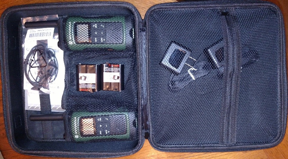 The T465 comes with two radios, push to talk headsets and a convenient carrying case.